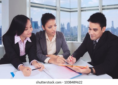 Business people having a discussion in a meeting