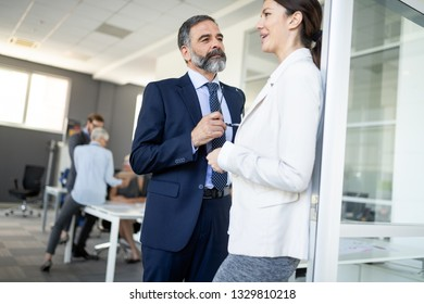 Business people having fun and chatting at workplace office