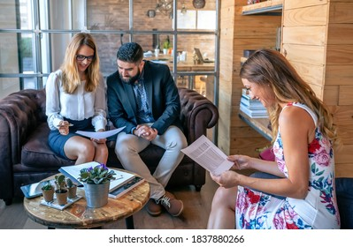 Business people having an informal work meeting sitting on the couch