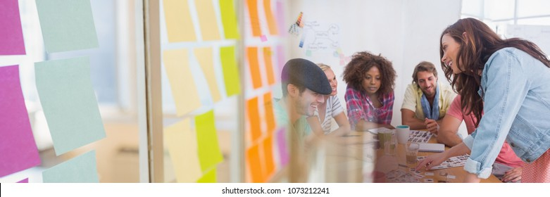 Business people having a meeting with colorful sticky notes transition effect
