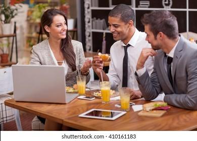 Business people Having Meeting In fast food Restaurant