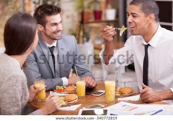 Business people Having Meeting In Outdoor Restaurant