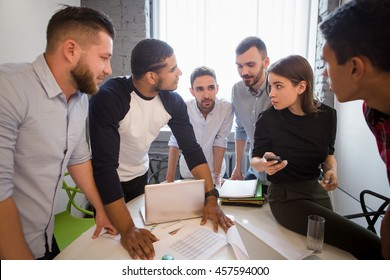 Business people having round table in office. Picture of many office workers working in board room all together. Business or freelance concept.
