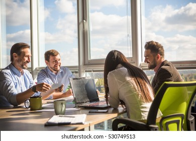 Business people having round table while working in board room in office. Colleagues discussing burning issues or problems about their company, enterprise or firm.