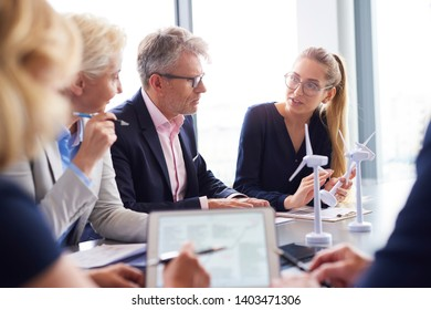 Business people having serious conversation in the conference room
