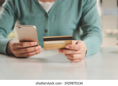 Business people hold credit cards and use smart phone in online shopping Business idea.
