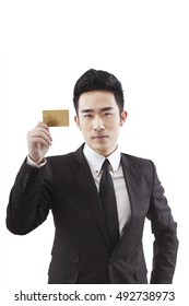 Business people holding a credit card