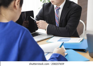 Business people holding a meeting