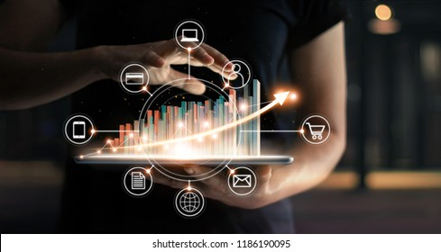 Business people holding tablet and statics graph chart growing in e-commerce global market and icon customer network connection. Arrow graph corporate future growth plan. Digital Online Marketing.