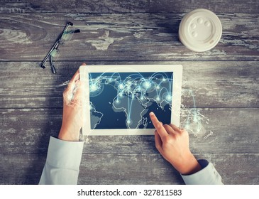 business, people, international communication, location and technology concept - close up of hands pointing finger to tablet pc computer screen with world map and network on table