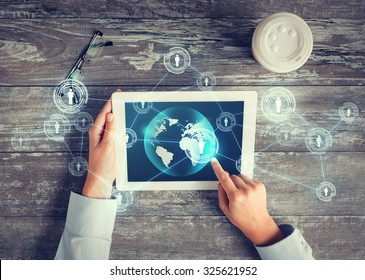 business, people, international communication and technology concept - close up of hands pointing finger to tablet pc computer screen with world map and internet contacts network on table