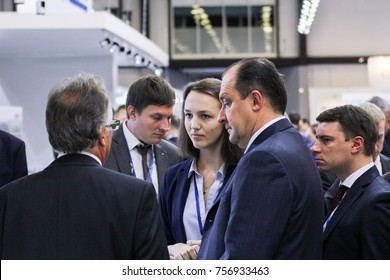 Business people with an interpreter. St. Petersburg, Russia - 3 October, 2017. Participants and visitors of the annual St. Petersburg Gas Forum.