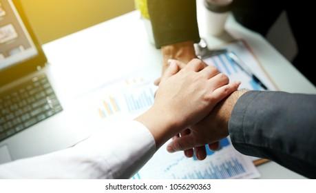 Business people join hands together. teamwork concept