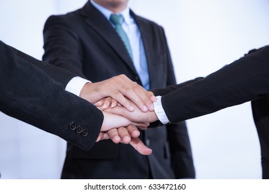 business people join stack hand while meeting in office as team teamwork togetherness collaboration concept
