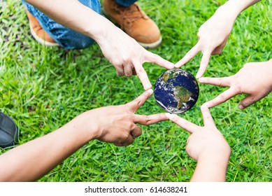 business people joined hands,Holding earth planet in the hand with green tree spring background. Corporate Social Responsibility or CSR concept. Elements of this image furnished by NASA