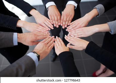 Business people joining hands. Team work