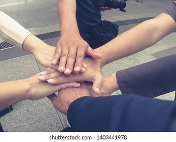 Business people joining hands. Team work concept. professional business people joining hands at work place station while celebrating completion of joint project