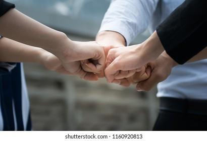 Business people joining hands.Businessmen handshake show teamwork