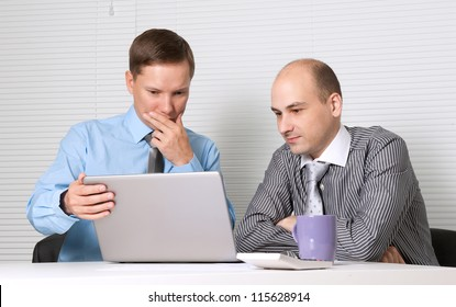 business people with laptop computer at office