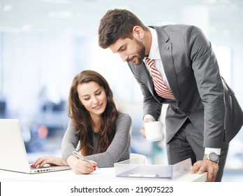 Business people with laptop, sitting at office and consulting.