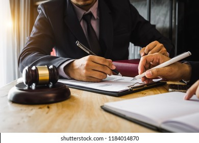 business people and lawyers discussing contract papers sitting at the table. Concepts of law, advice, legal services. in morning light