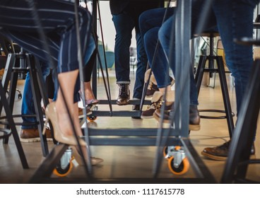 Business people legs under the office table while they are working