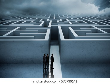 Business people looking at maze against digitally generated background