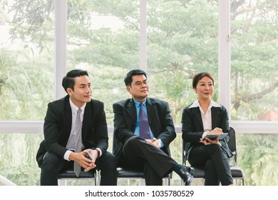 Business people looking at presentation about project