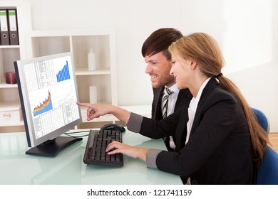 Business people looking at sales growth charts in the office