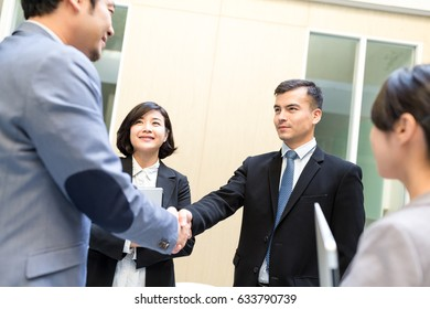 Business people make a deal