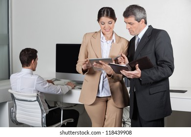 Business people making appointments with tablet pc and datebook