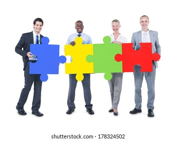 Business People Making a Jigsaw Puzzle Connection