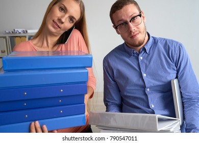 Business people with many folders looking at camera