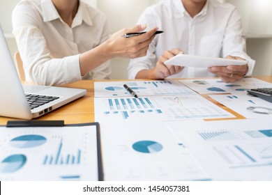 Business People Meeting to analyse and discuss and brainstorming the financial report chart data in office, Financial advisor teamwork and accounting concept