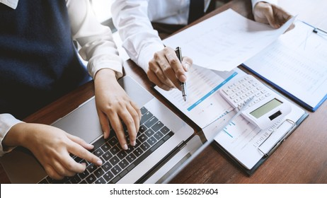 Business people meeting discussing with data documents in conference room.