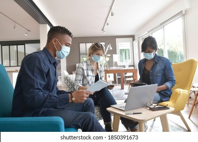 Business people meeting with face masks in the office