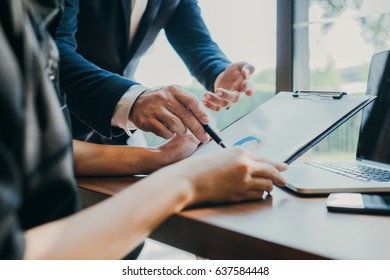 Business people meeting hand pointing at business documents and ideas