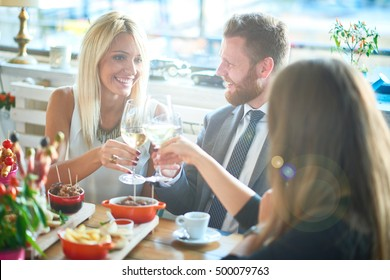 business people meeting in modern restaurant, colleagues having dinner and take drink after work