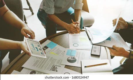 Business people meeting at office writing memos on sticky notes. planning strategy and brainstorming, colleagues thinking concept