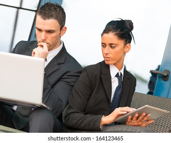Business people meeting outside with electronic tablet and computer