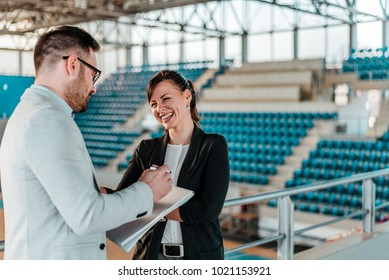 Business people meeting in sport arena.