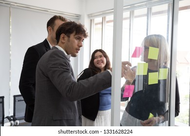 Business people meeting team, briefing and discussing new plan. Analyzing with teamwork on project in office and use post it notes to share idea. Brainstorming and conference corporate concept