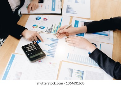 Business People Meeting using calculator,stock market chart paper for analysis Plans to improve quality next month. Conference Discussion Corporate Concept