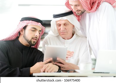 Business people at Middle east working on tablet PC