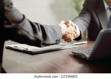 Business people negotiate and shake hands with partner or investor, successful conversation and agreement concept