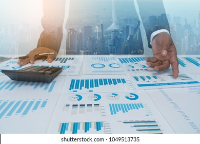 Business people negotiating a contract, they are pointing on a document and discussing together.businessmen are negotiating deal agreement collaboration talk in office concept.