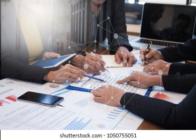 Business People Negotiating a Contract, they are Pointing on a document and Discussing together.Businessmen and Client DEAL Agreement Collaboration talk in office concept.