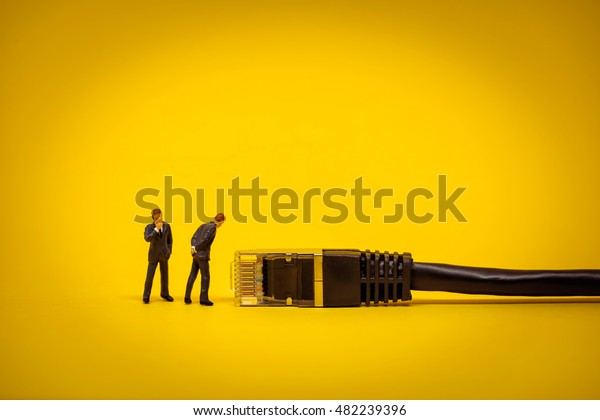 Business people with network cable. Technology concept.