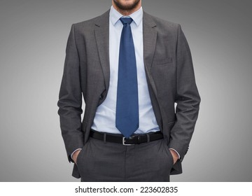 business, people and office concept - close up of businessman over gray background