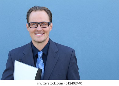 Business, people and office concept - happy smiling businessman with glasses in suit